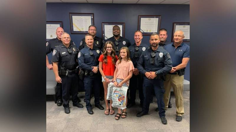 Two girls from Midland were recognized by police after turning in lost money.