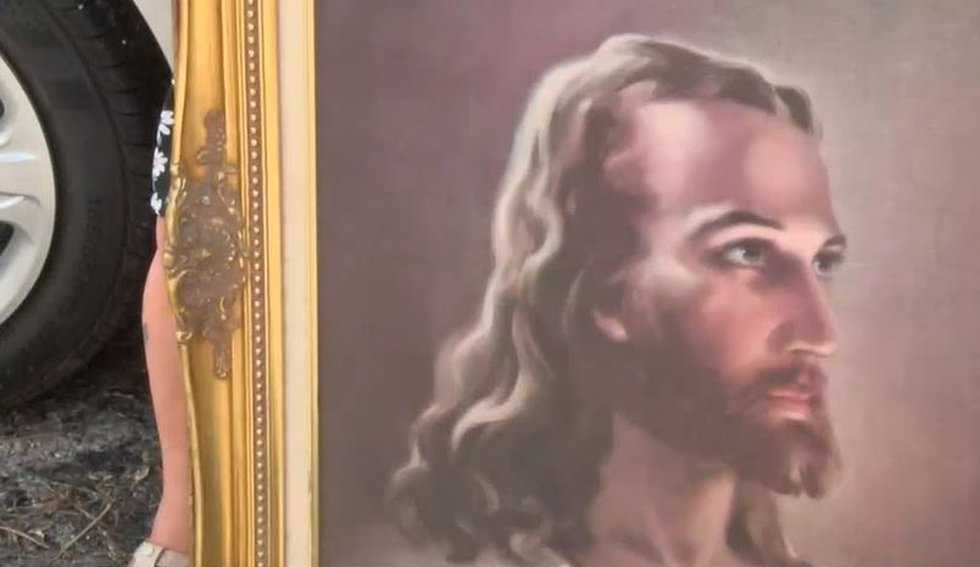 Lucy Gomez's painting of Jesus miraculously made it through the fire unharmed.