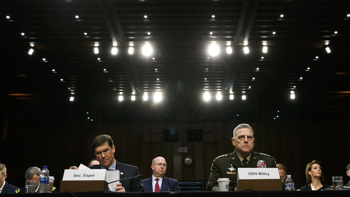 Defense Secretary Mark Esper, left, and Chairman of the Joint Chiefs of Staff Gen. Mark Milley listen during a Senate Armed Services Committee on budget posture, Wednesday, March 4, 2020, on Capitol Hill in Washington.