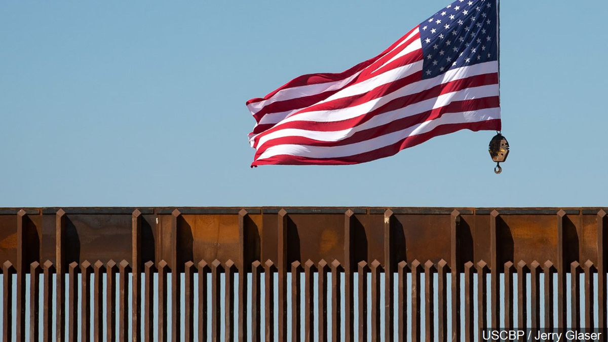 U.S. flag flying above the US-Mexico border wall in McAllen, Texas.