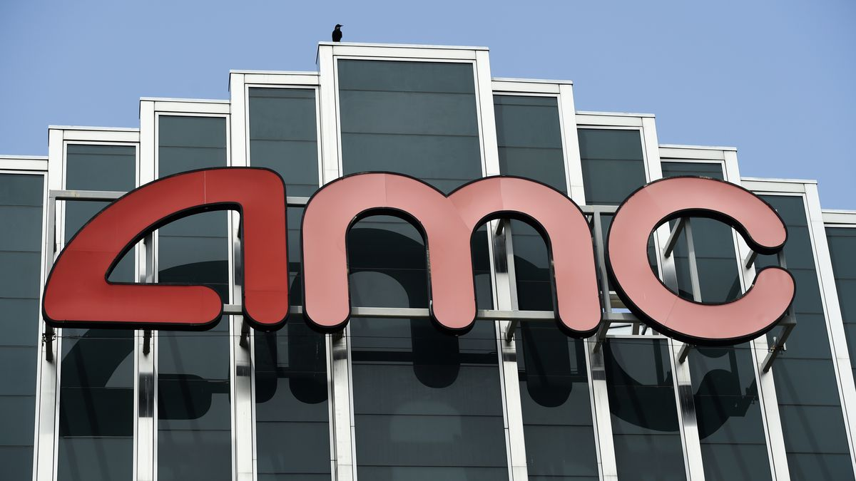 In this April 29, 2020 file photo, the AMC sign appears at the AMC Burbank 16 movie theater complex in Burbank, Calif.