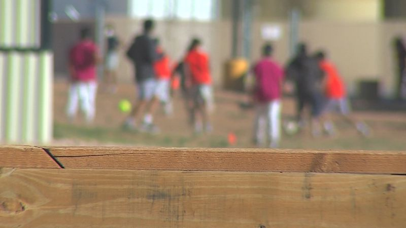 Migrant teens play soccer inside a migrant facility in Midland, TX.