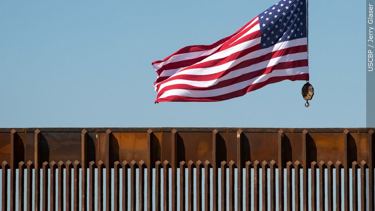 The U.S. flag flying above a U.S.-Mexico border wall in McAllen, Texas on October 30, 2020.