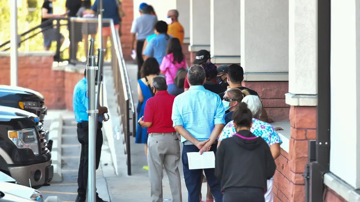 Voters waited outside of the Bexar County Elections Department in San Antonio to drop off their mail-in ballots, voter registration applications or be trained as poll workers on Oct. 5.