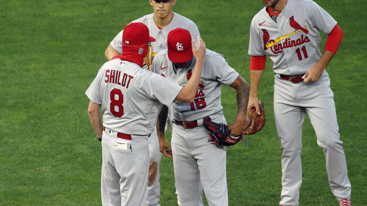 St. Louis Cardinals manager Mike Shildt (8) consoles pitcher Carlos Martinez on the cap as he pulls him following a solo home run by Minnesota Twins' Josh Donaldson in the fourth inning of a baseball game Tuesday, July 28, 2020, in Minneapolis.
