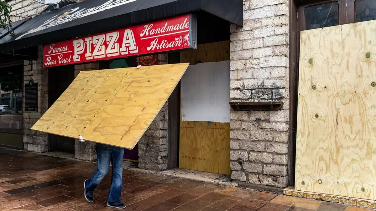 Workers boarded up bars on Sixth Street in Austin after Gov. Greg Abbott closed bars in Texas for the second time in three months because of the COVID-19 pandemic on June 26.