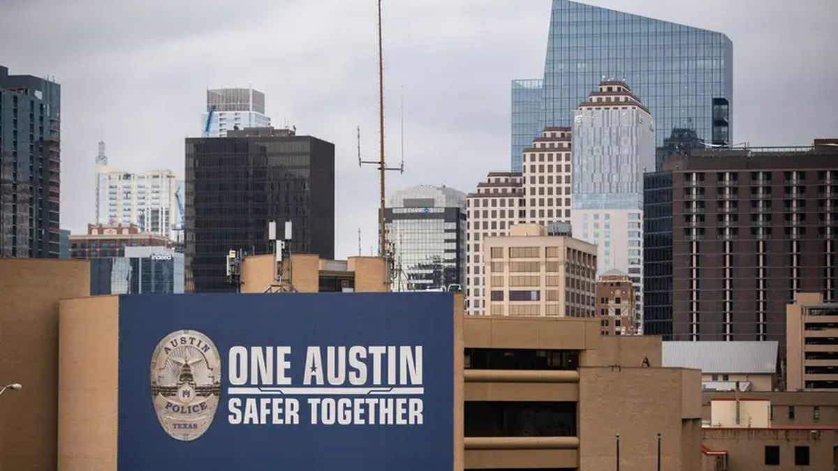 The Austin Police Department building with the Austin skyline in the background. Over the...