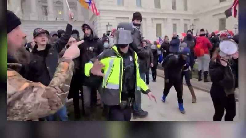 The DOJ released video that shows one of the Jan. 6 rioters assaulting a police officer.