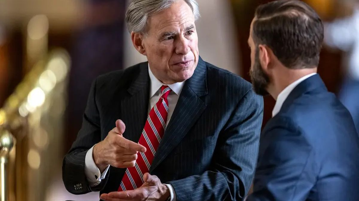 Gov. Greg Abbott speaks with lawmakers on the House floor during the legislative session on May...